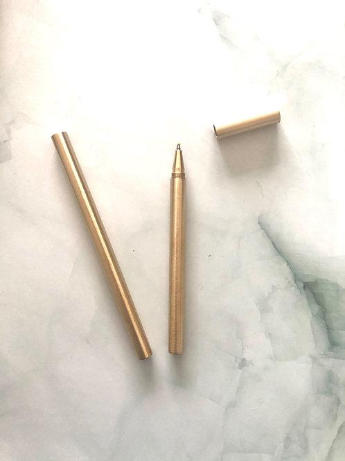 Stylo pointe gel noire corps métallique doré