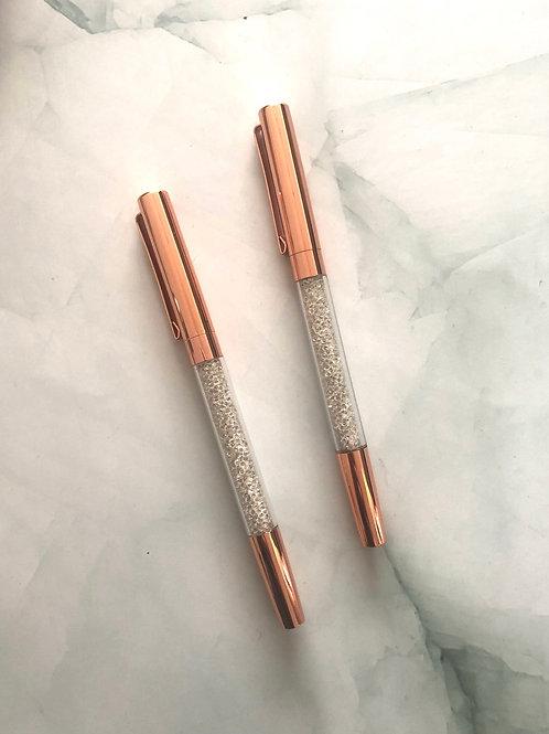 Stylo pointe noire corps métallique rose gold, paillettes blanches