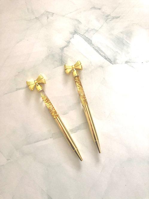 Stylo pointe noire doré , noeud et paillettes dorées