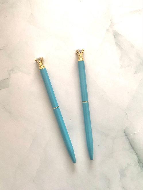 Stylo pointe noire corps bleu et or , petit diamant
