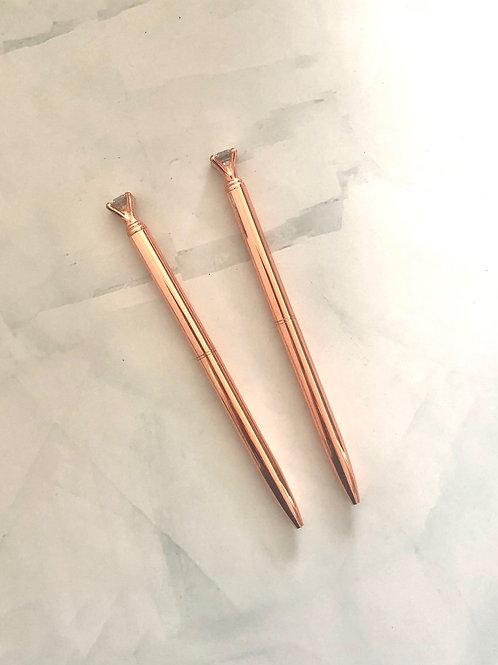Stylo pointe noire corps rose gold , petit diamant
