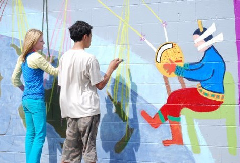 People of all ages helped to create the mural project