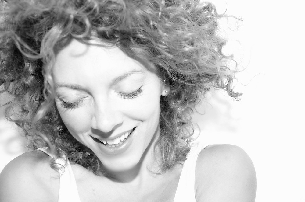 Flickr Image Source: Black and white photo of a happy woman, Mind It Ltd, Wellbeing workshops, wellbeing webinars, wellbeing training, wellbeing consultancy, Leeds, England