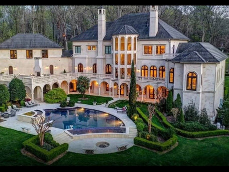 WHILE WE WERE BUSY OPENING GIFTS CARDI AND OFFSET WERE BUYING MANSIONS IN ATL!
