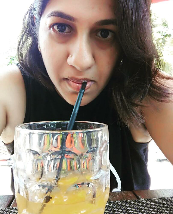 Girl sipping cocktail