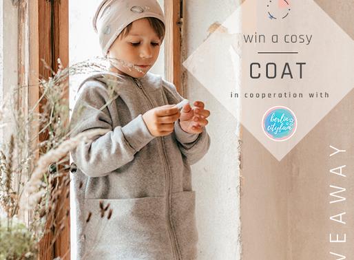 Gewinnt einen COZY CACAO Coat von Belamaikind