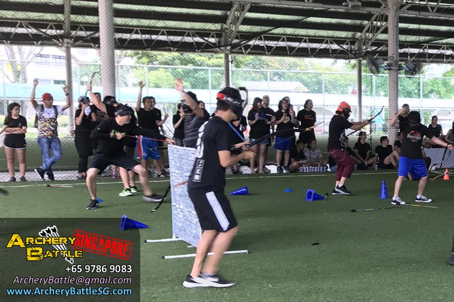 Go team go! | Archery Tag Singapore