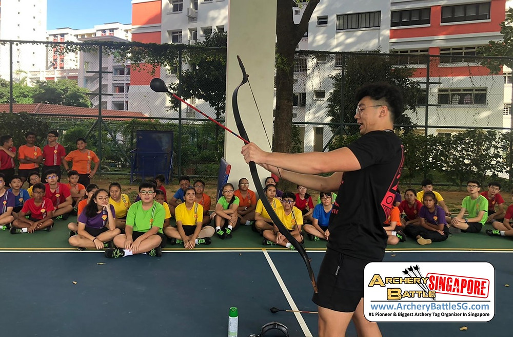 Briefing for students in Archery Tag Singapore team building