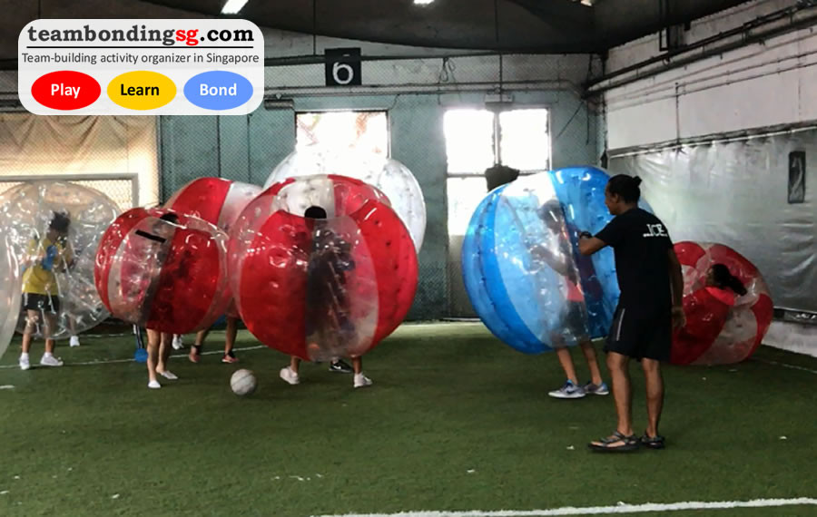 Snatching the soccer ball in Bubble Soccer by TeamBondingSG.com