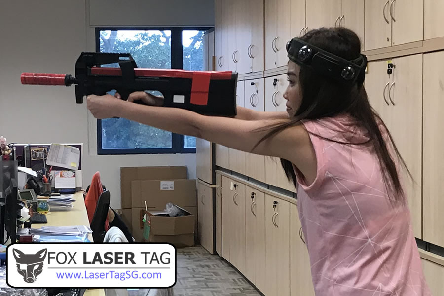 Laser Tag player with gun and head sensor.