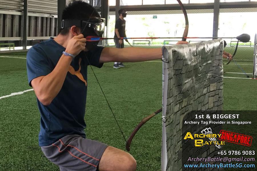 Shooting behind cover in Archery Tag Singapore