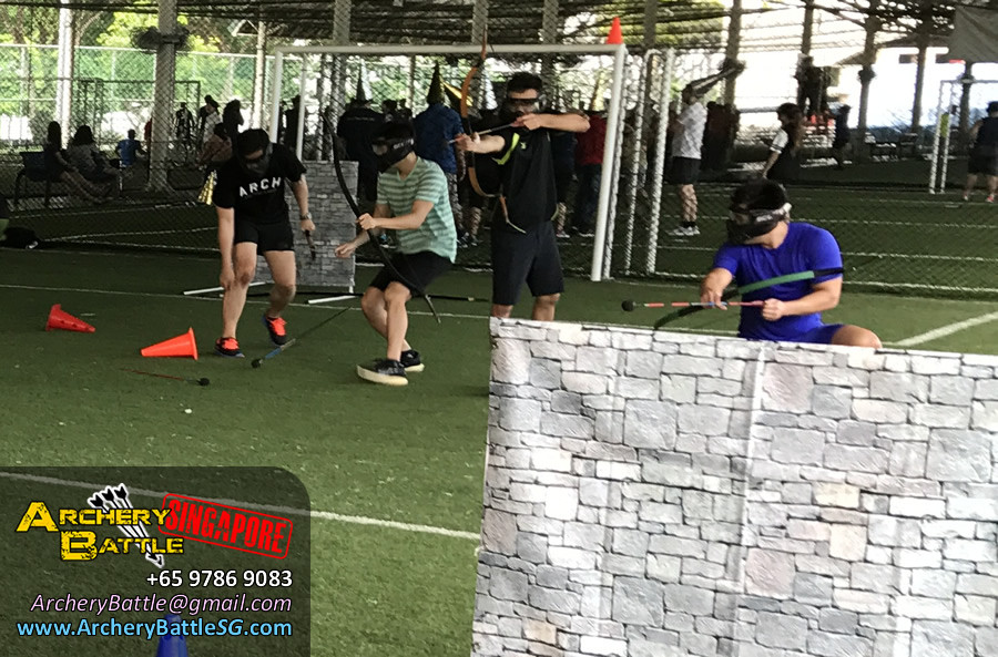 Calmly taking aim for a good shot | Archery Tag Singapore
