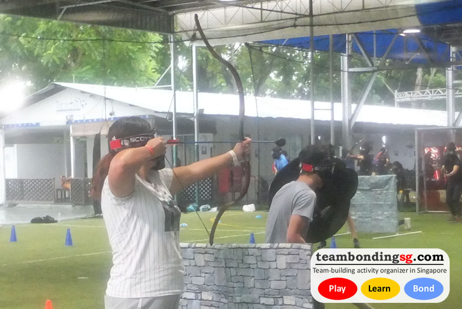 Shooting Archery Tag behind cover.