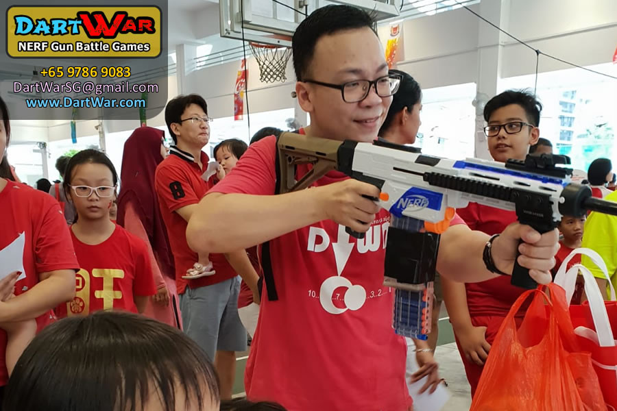 Adults love these cool rifles! - NERF Shooting Booth at Punggol