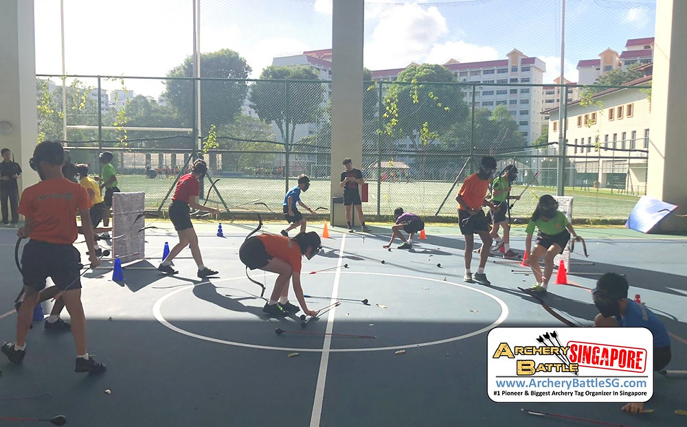 Rush for arrows in the middle in Archery Tag Singapore team building