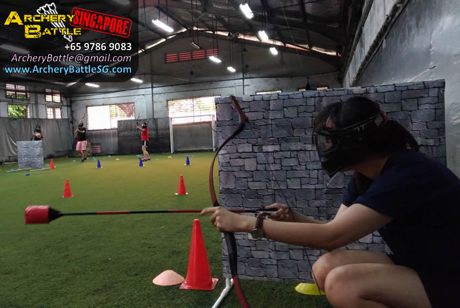 Smart girl hiding behind the wall | Kneeling to shoot | Archery Tag Singapore