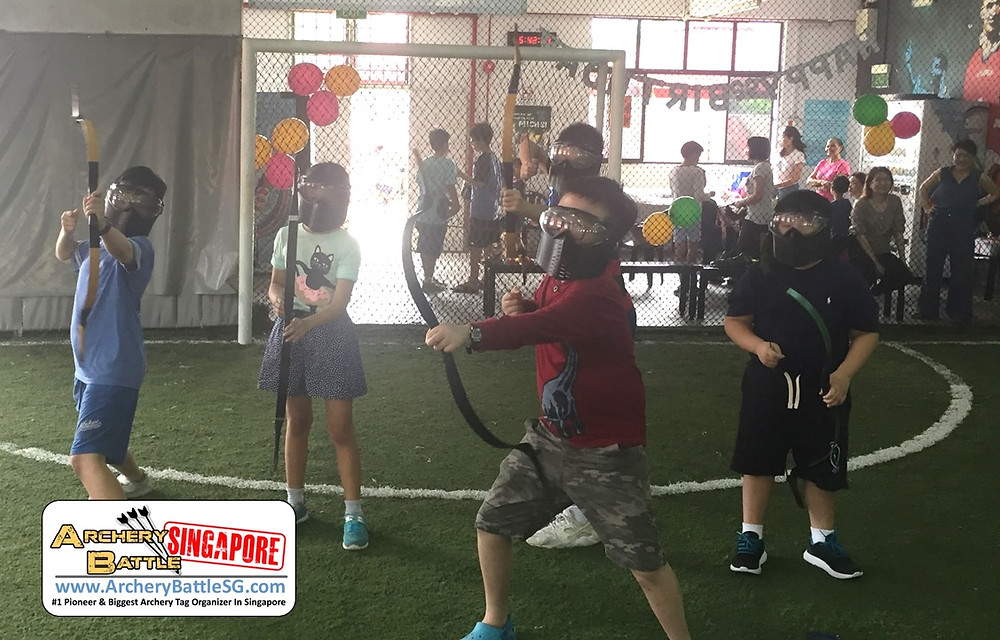 Archery Tag kids birthday party pose