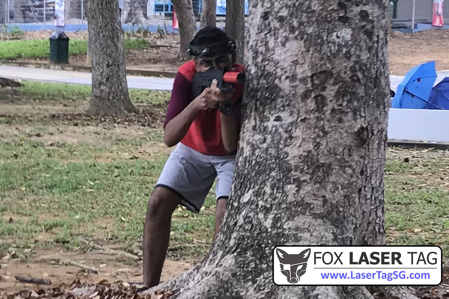 Hiding behind tree - FOX Laser Tag Singapore