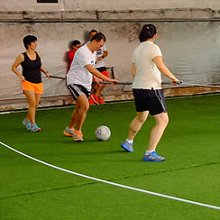 Holding onto the poles - Human Foosball Singapore