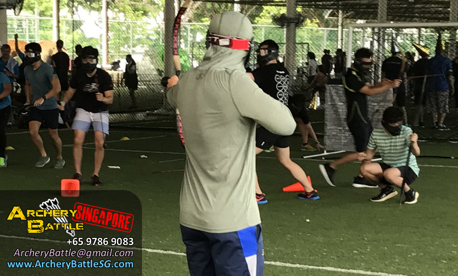 Wear all green, this guy thinks he's Arrow from Marvel lar sia | Archery Tag Singapore