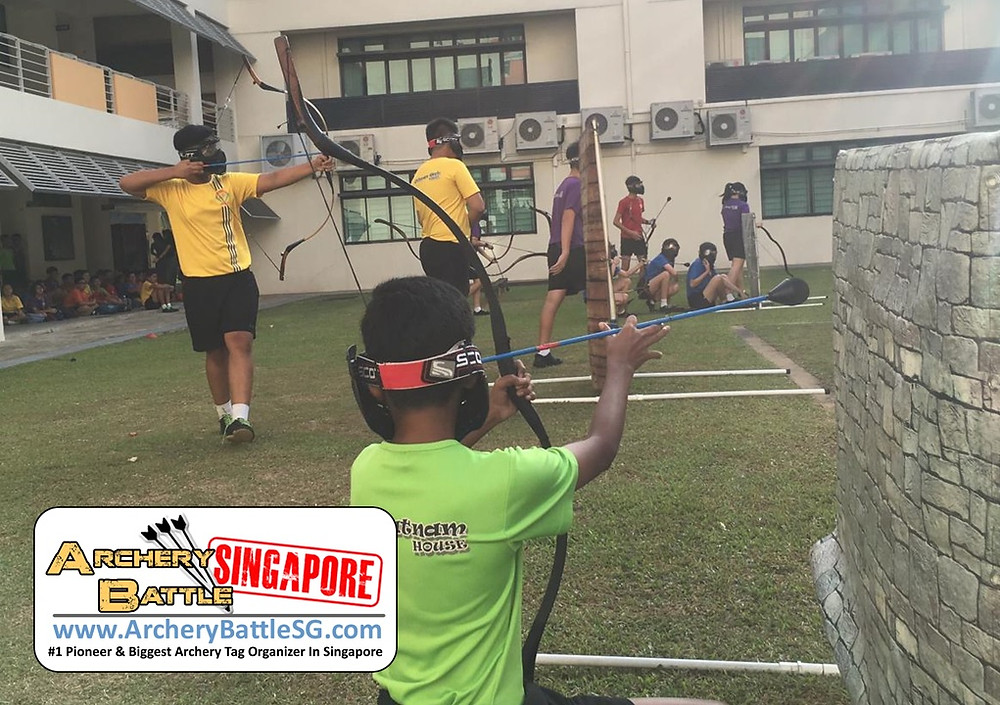 Obstacles and teamwork in Archery Tag Singapore