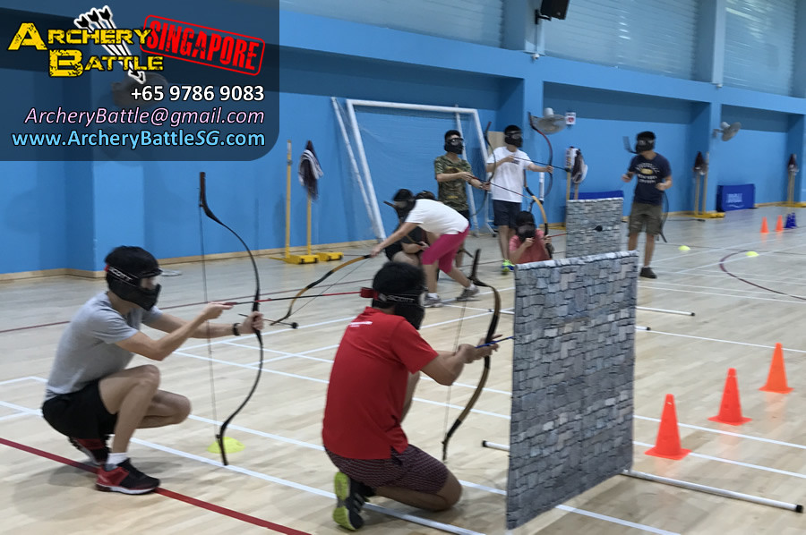 Taking cover behind the obstacles in an Archery Tag game