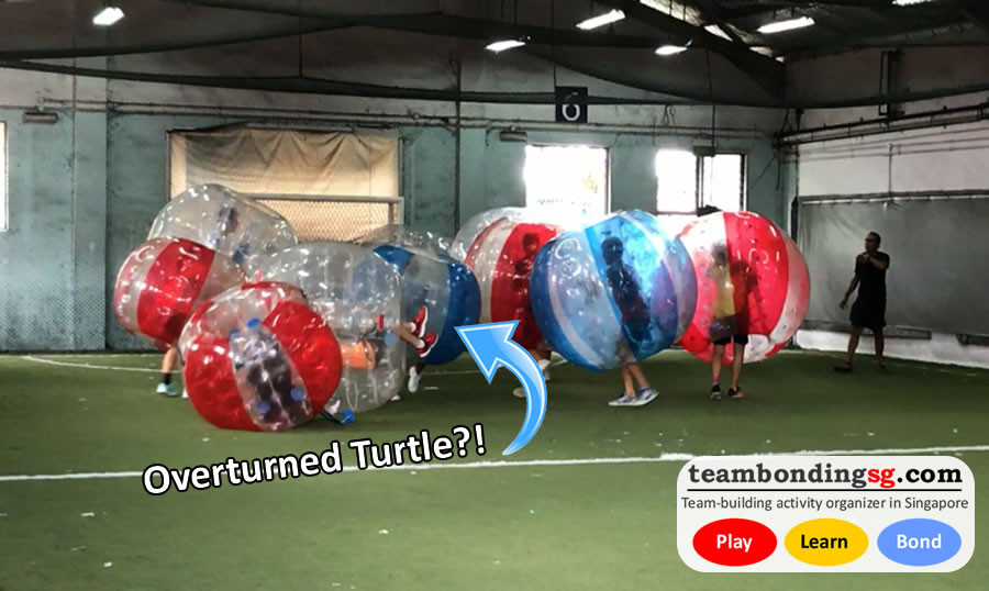 overturned turtle in Bubble Soccer by TeamBondingSG.com