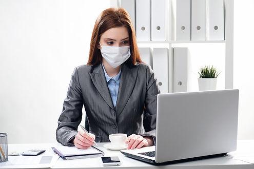 masked woman at computer.jpg