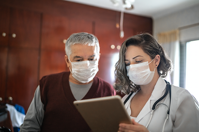 nurse with patient at front desk.png