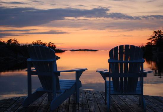 muskoka chairs on lake.jpg