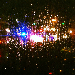 Car Headlights in Thunderstorm