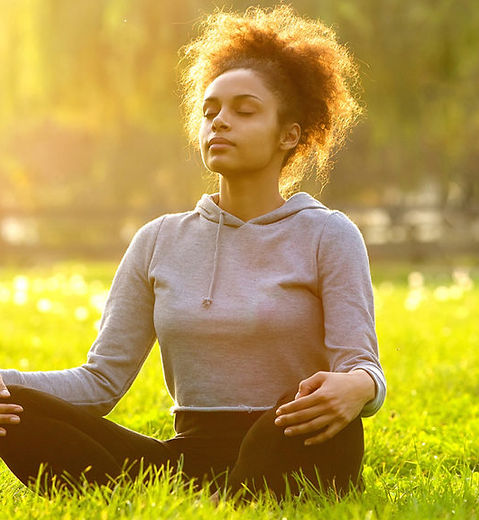 African-american-woman-meditating-in-nat