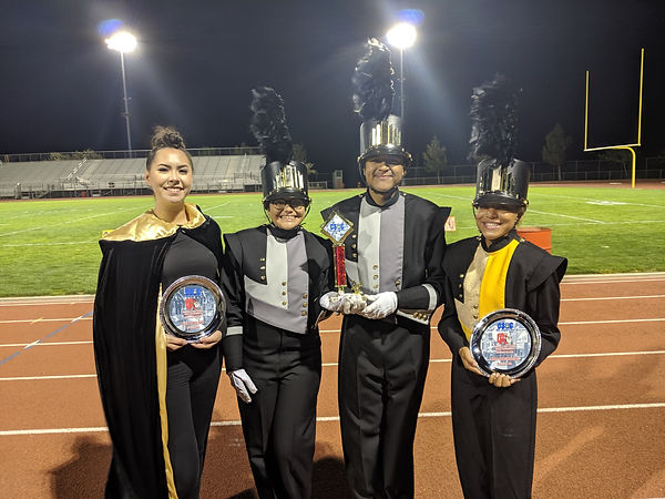 The leaders of the Black & Gold Regiment holding awards.