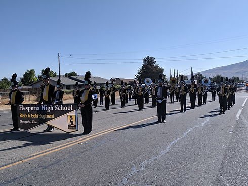 The Black & Gold Regiment waiting for a parade to start.