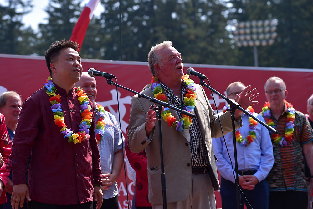 Mayor Derek Corrigan, Councillor James Wang, City of Burnaby, Were giving a speech