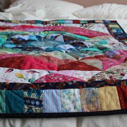 Hand-stitched patchwork quilt