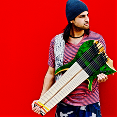 Musician and Guitarrist Felix Martin with one of his custom made guitars. (Photo courtesy of Felix Martin).