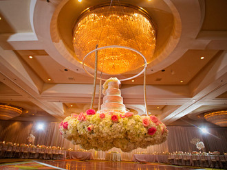 A Six-Tier Wedding Cake Suspended From a Ceiling