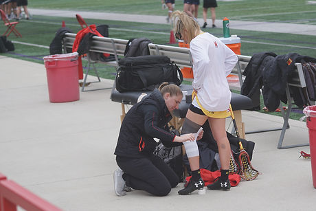 woman taping knee of woman_edited_edited.jpg