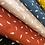 Thumbnail: Popeline de coton -  Plume /fond brun - 9€/m