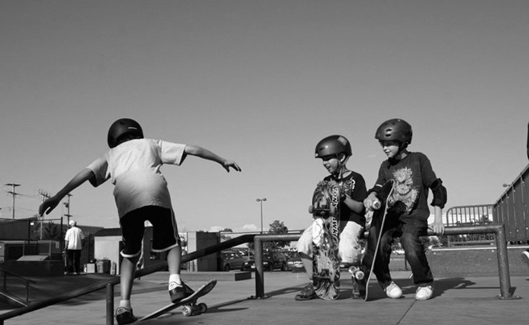 Young boys having fun learning to skateboard