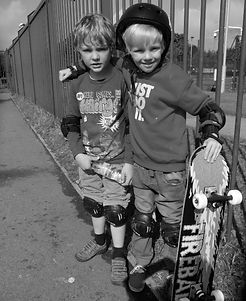 Two boys who have become friends from learning to skateboard