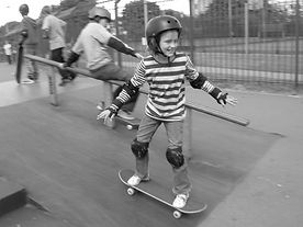 Young girl enjoying learning to skateboard