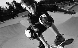 Young boy learning to skateboard