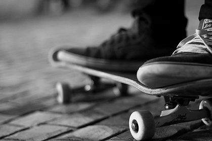 Close up of feet on a skateboard