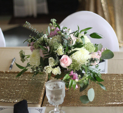 Centerpiece with Gold Sequin runner and chair coveres