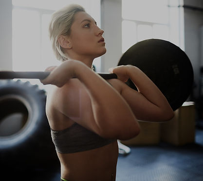 Pretty-woman-lifting-barbell-396992_edit