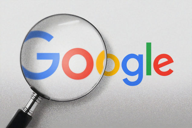 A magnifying glass over Google's logo