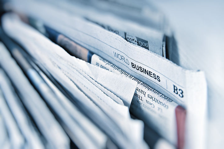a close shot of multple newspapers stacked up on top of each other