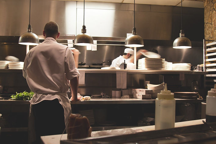 An action shot of a kitchen from a restaurant